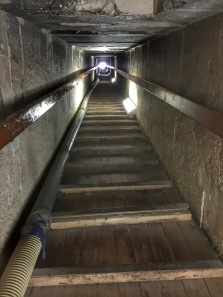 Down the shaft.